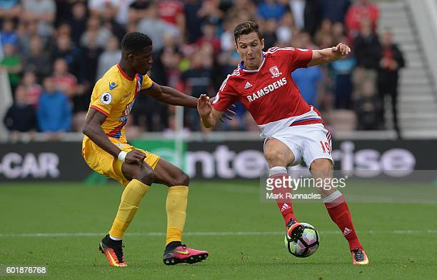 Stewart Downing of Middlesbrough and Wilfried Zaha of Crystal Palace battle for possession during the Premier League match between Middlesbrough and...