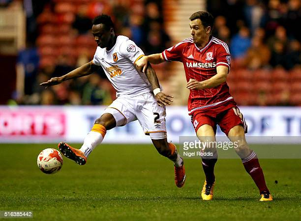 Stewart Downing of Middlesbrough challenges Moses Odubajo of Hull City during the Sky Bet Championship match between Middlesbrough and Hull City at...