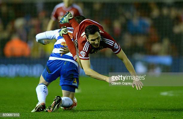 Stewart Downing of Middlesbrough is tackled by Andrew Taylor of Reading during the Sky Bet Championship match between Middlesbrough and Reading at...