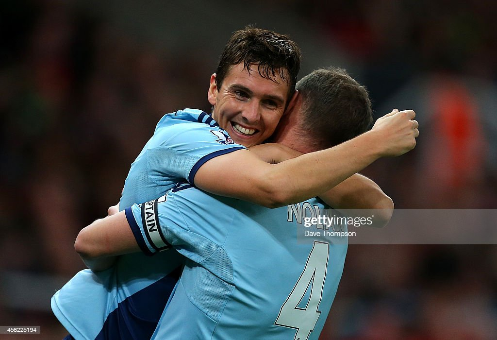 Stewart Downing of West Ham celebrates scoring his team's second goal with team-mate Kevin Nolan during the Barclays Premier League match between Stoke City and West Ham United at the Britannia Stadium on November 1, 2014 in Stoke on Trent, England.