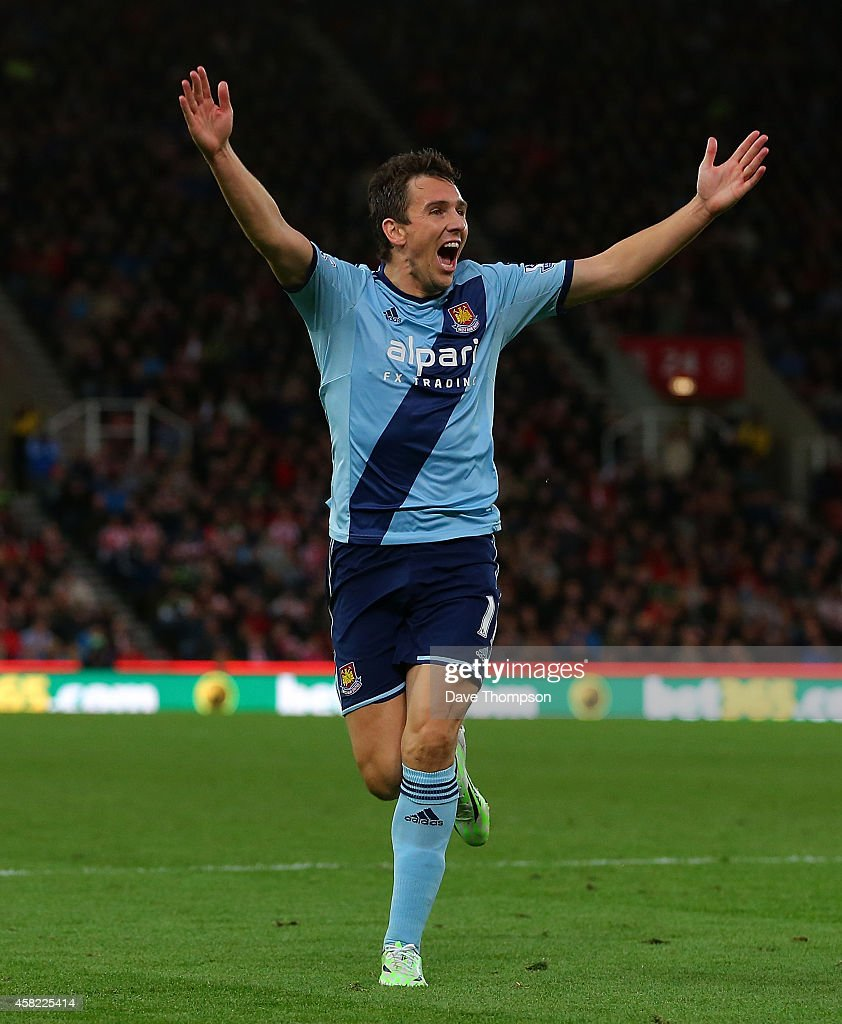 Stewart Downing of West Ham celebrates scoring his team's second goal during the Barclays Premier League match between Stoke City and West Ham United at the Britannia Stadium on November 1, 2014 in Stoke on Trent, England.