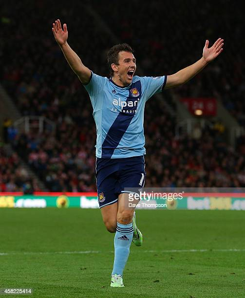 Stewart Downing of West Ham celebrates scoring his team's second goal during the Barclays Premier League match between Stoke City and West Ham United...