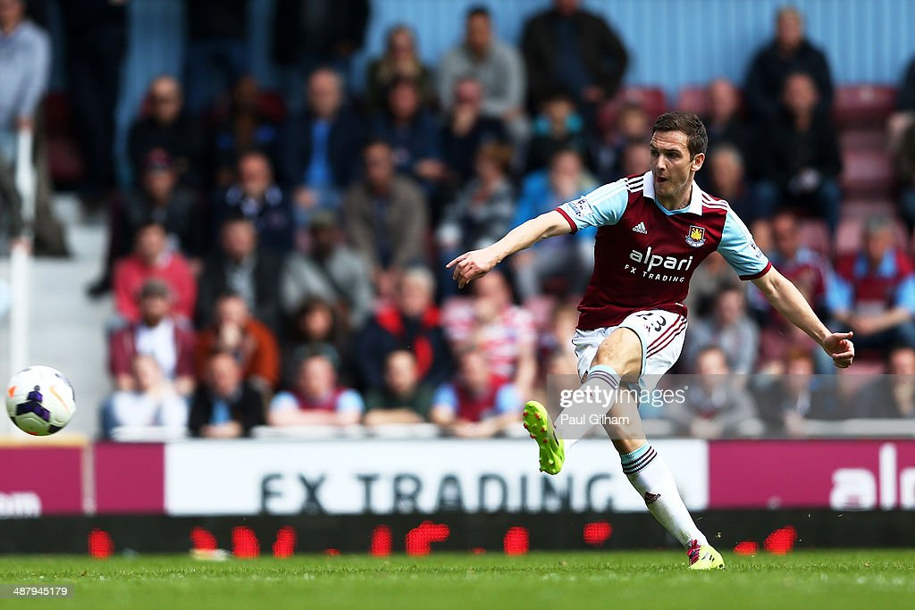 Stewart Downing of West Ham scores his team'second goal from a free kick during the Barclays Premier League match between West Ham United and Tottenham Hotspur at Boleyn Ground on May 3, 2014 in London, England.