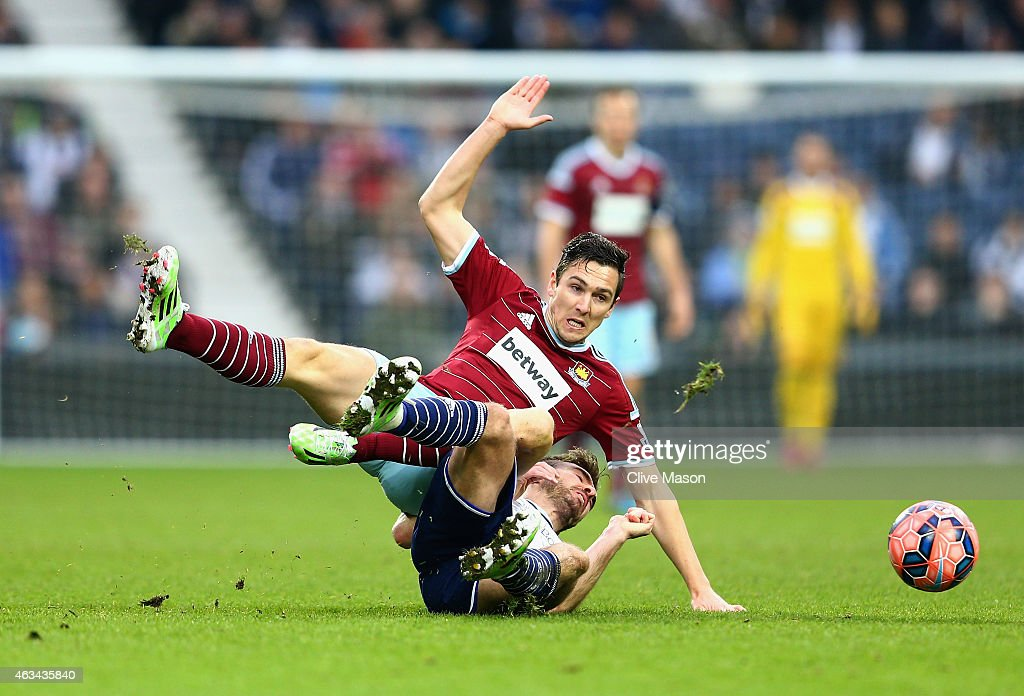 <a gi-track='captionPersonalityLinkClicked' href=/galleries/search?phrase=Stewart+Downing&family=editorial&specificpeople=238961 ng-click='$event.stopPropagation()'>Stewart Downing</a> of West Ham United is challenged by <a gi-track='captionPersonalityLinkClicked' href=/galleries/search?phrase=James+Morrison+-+Soccer+Player&family=editorial&specificpeople=4427611 ng-click='$event.stopPropagation()'>James Morrison</a> of West Bromwich Albion during the FA Cup Fifth Round match between West Bromwich Albion and West Ham United at The Hawthorns on February 14, 2015 in West Bromwich, England.