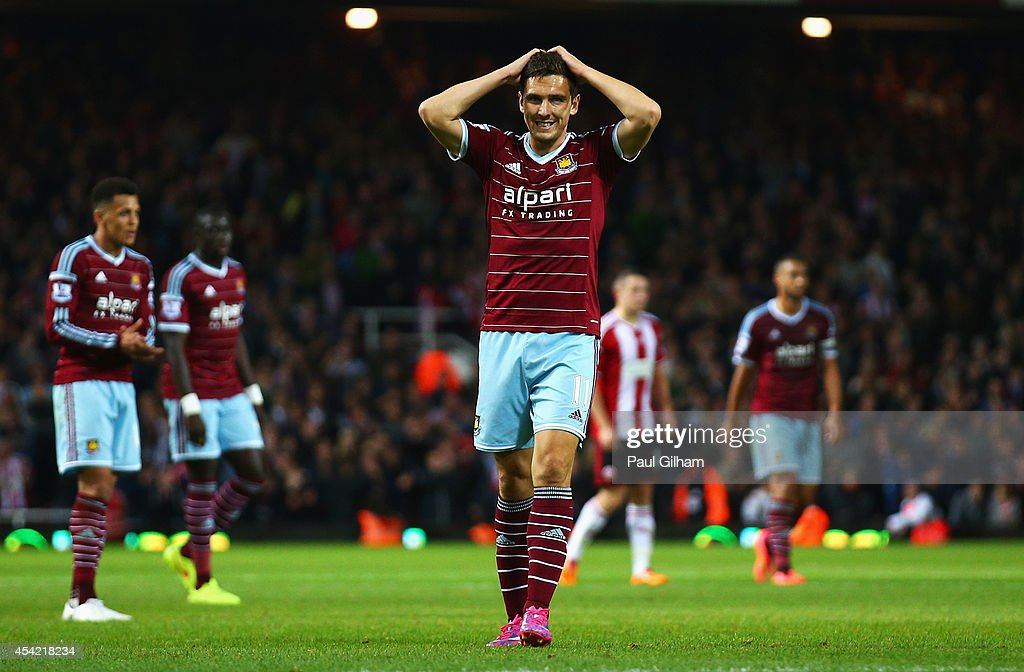 Stewart Downing of West Ham United reacts during the Capital One Cup Second Round match between West Ham United and Sheffield United at Boleyn Ground on August 26, 2014 in London, England.