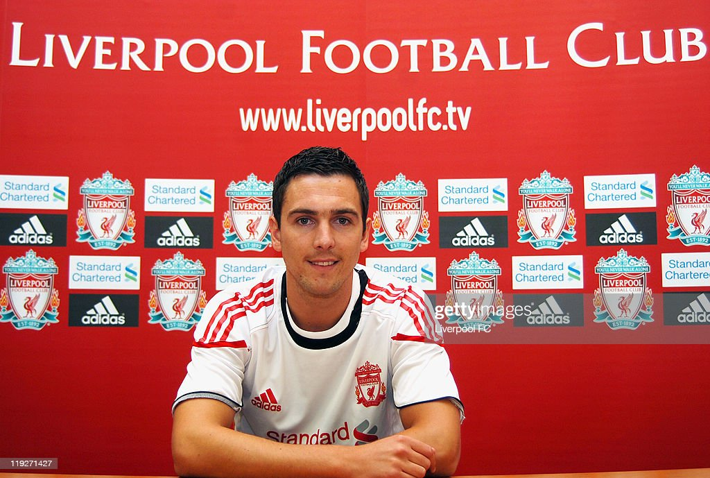 MINIMUM FEES APPLY - 150GBP OR LOCAL EQUIVALENT, PER IMAGE) (THE SUN OUT): Stewart Downing poses for photos as he signs for Liverpool FC at Melwood Training Ground on July 14, 2011 in Liverpool, England.