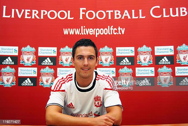 Stewart Downing poses for photos as he signs for Liverpool FC at Melwood Training Ground on July 14 2011 in Liverpool England