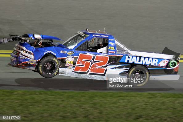 Stewart Friesen's truck is towed back to the garage after a 1st lap wreck during NASCAR Camping World Truck Series NextEra Energy Resources 250 on...