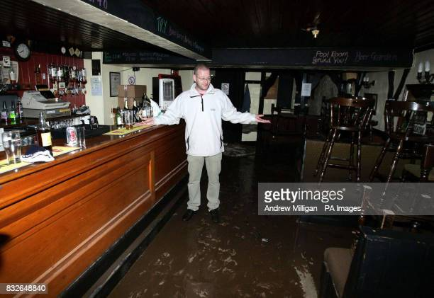 Stewart Hutchison surveys the damage to the Jolly Beggars Hotel bar in Milnathort near Kinross where homes were evacuated after the River Queich...
