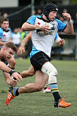Stewart McVinnie of Grammar Carlton gets past the College Rifles tackler during the match between College Rifles and Grammar TEC at College Rifles on...
