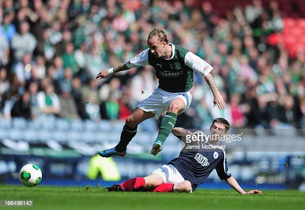 Stewart Murdoch of Falkirk battles with Leigh Griffiths of Hibernian during The William Hill Scottish Cup Semi Final between Falkirk and Hibernian at...