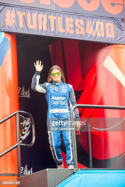 StewartHaas Racing Aspen Dental Ford driver Danica Patrick waves to the fans during the Monster Energy Cup Series Tale of the Turtles 400 driver...