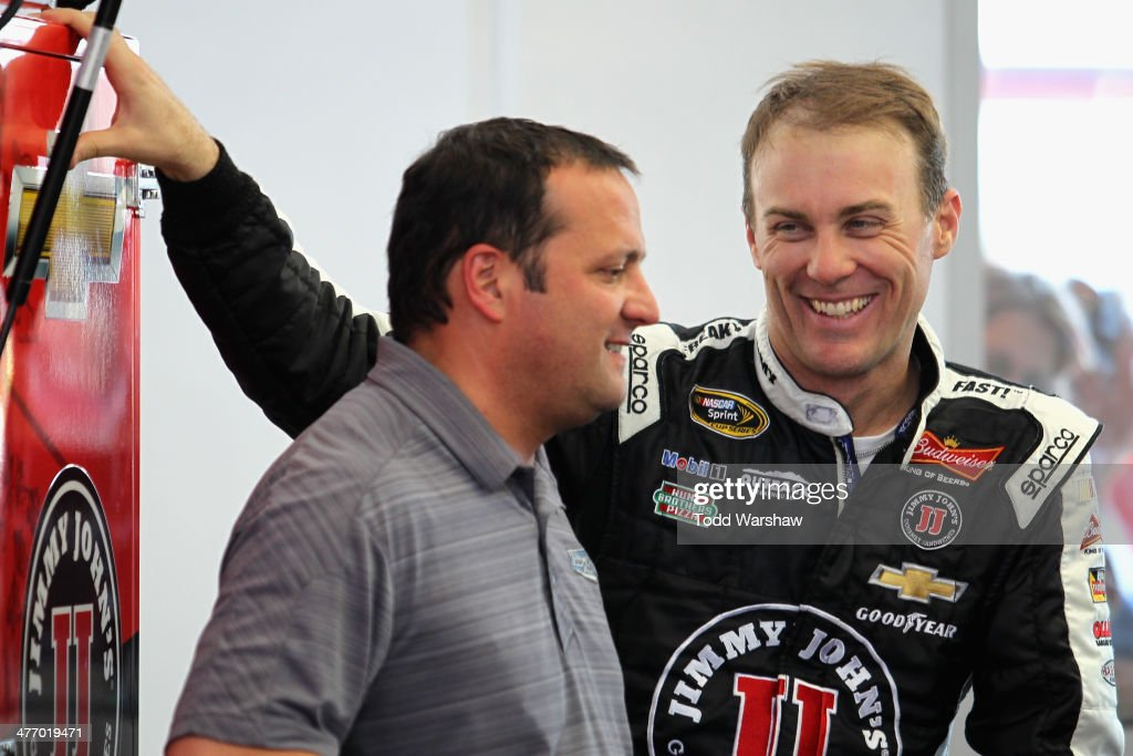 Stewart-Haas Racing competition director <a gi-track='captionPersonalityLinkClicked' href=/galleries/search?phrase=Greg+Zipadelli&family=editorial&specificpeople=559825 ng-click='$event.stopPropagation()'>Greg Zipadelli</a> talks to <a gi-track='captionPersonalityLinkClicked' href=/galleries/search?phrase=Kevin+Harvick&family=editorial&specificpeople=209186 ng-click='$event.stopPropagation()'>Kevin Harvick</a>, driver of the #4 Jimmie John's Chevrolet, in the garage during a testing session at Las Vegas Motor Speedway on March 6, 2014 in Las Vegas, Nevada.