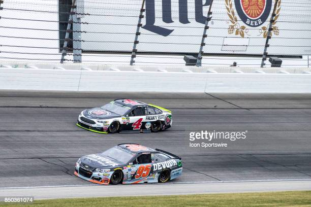 StewartHaas Racing Jimmie John's Ford driver Kevin Harvick and Leavine Family Racing Devour Frozen Meals Chevy driver Michael McDowell during the...