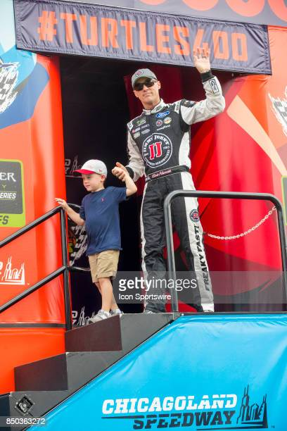 StewartHaas Racing Jimmie John's Ford driver Kevin Harvick waves to the fans during the Monster Energy Cup Series Tale of the Turtles 400 driver...