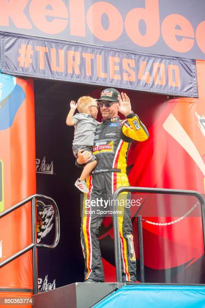 StewartHaas Racing Rush Truck Centers Ford driver Clint Bowyer waves to the fans during the Monster Energy Cup Series Tale of the Turtles 400 driver...