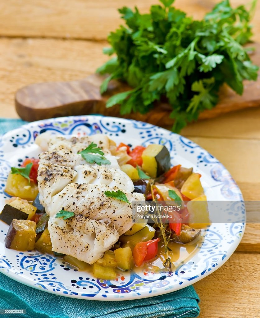 Stewed cod fish with vegetables stock photo getty images for What vegetables go with fish