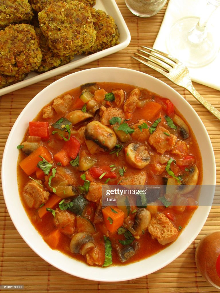 Stewed vegetables with soy and mushrooms in a white bowl : Photo