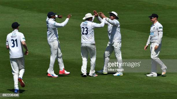 Stiaan van Zyl of Sussex is congratulated by team mates Alan Wells Chris Jordan Chris Nash and Luke Wright after taking a catch in the deep to...