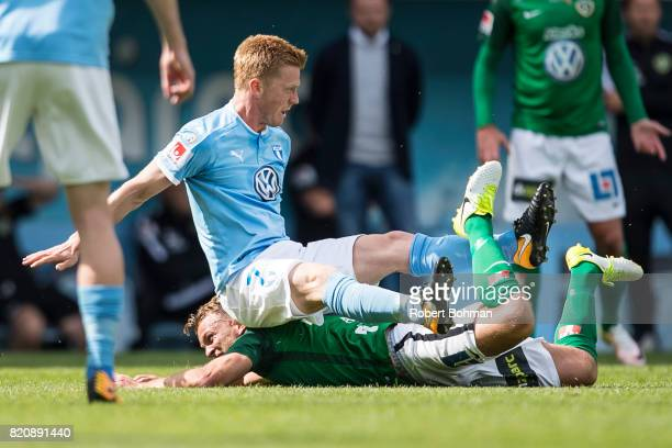 Stian Aasmundsen of Jonkopings Sodra and Anders Christiansen of Malmo FF during the Allsvenskan match between Malmo FF and Jonkopings Sodra IF at...