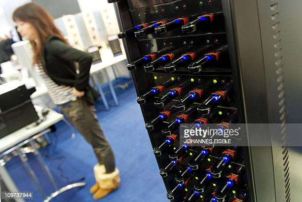 A USB stick duplicator is pictured at the CeBIT the world's biggest IT fair on March 3 2011 in Hanover central Germany More than 4200 tech firms from...