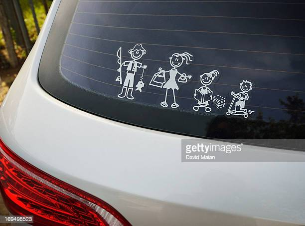 Stick figure family on the back of a car