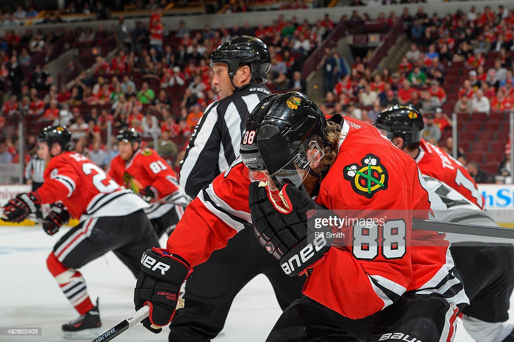 A stick gets caught in the visor of Patrick Kane #88 of the Chicago Blackhawks in Game Two of the Western Conference Final against the Los Angeles Kings during the 2014 NHL Stanley Cup Playoffs at the United Center on May 21, 2014 in Chicago, Illinois.