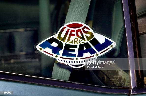 A sticker declares the existence of flying saucers from the window of a car parked on property near Jamul CA October 15 purchased by the Unarius...