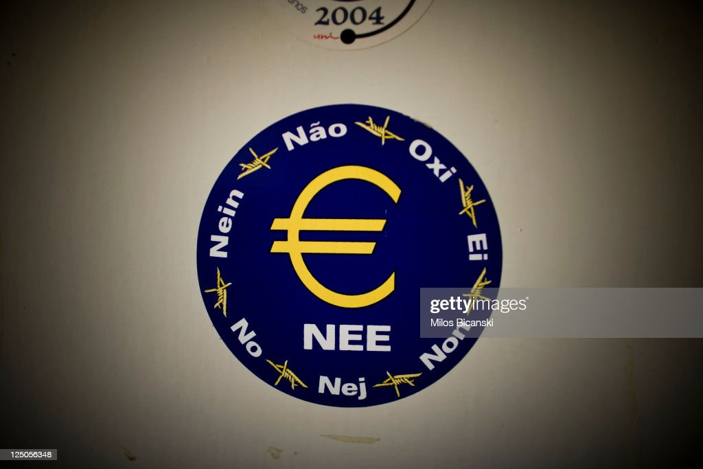 A sticker is seen on the door in the National Telecomunication Company on September 15, 2011 in Greece. As Greece's position in the Eurozone remains uncertain, a cabinet meeting today discussed how the country may implement a new round of austerity measures in order to fend off default and to ensure they continue to receive rescue loans. The troubled country is in its third year of recession and unemployment has risen to 16.3% compared with 11.8% this time last year.