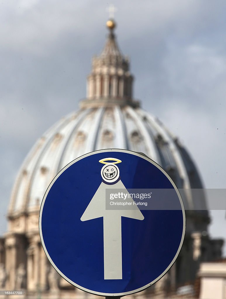 A sticker of a smiley face and a halo adorns a road traffic sign near to St Peter's Basilica on March 10, 2013 in Rome, Italy. Cardinals are set to enter the conclave to elect a successor to Pope Benedict XVI after he became the first pope in 600 years to resign from the role. The conclave is scheduled to start on March 12 inside the Sistine Chapel and will be attended by 115 cardinals as they vote to select the 266th Pope of the Catholic Church.