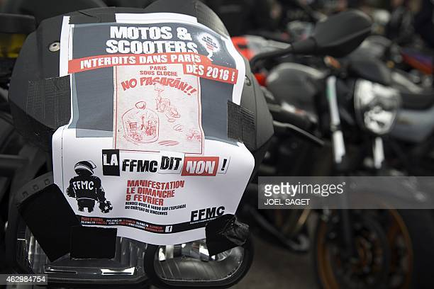 A sticker of the French Federation of Angry Bikers reading 'Motorbikes and scooters banned in Paris in 2016 the FFMC says no ' is seen onto a bike as...