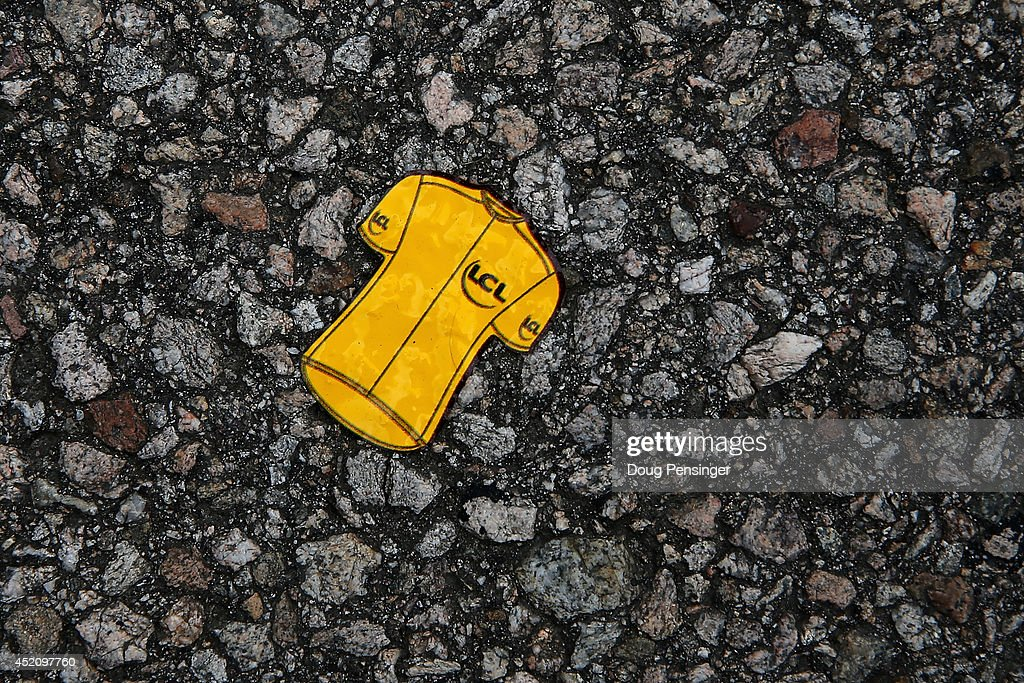 A sticker of the overall race leader's yellow jersey adorns the road at the start of stage nine of the 2014 Le Tour de France from Gerardmer to Mulhouse on July 13, 2014 in Gerardmer, France.