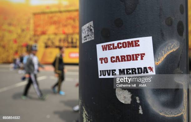 A sticker on a lamp post saying Welcome to Cardiff Juve Merda ahead of the UEFA Champions League Final match between Juventus and Real Madrid at...