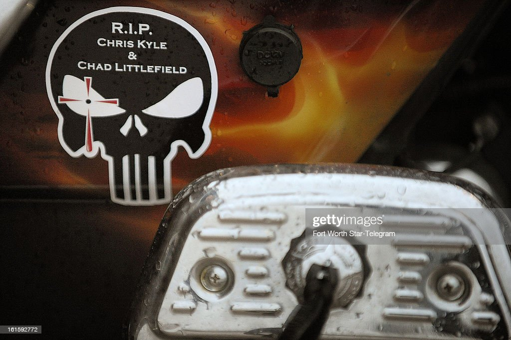 A sticker on David Calhoun's motorcycle memorializing Chris Kyle and Chad Littlefield before the funeral procession for Chris Kyle at Multi-Purpose Stadium, in Midlothian, Texas, Tuesday, February 12, 2013.