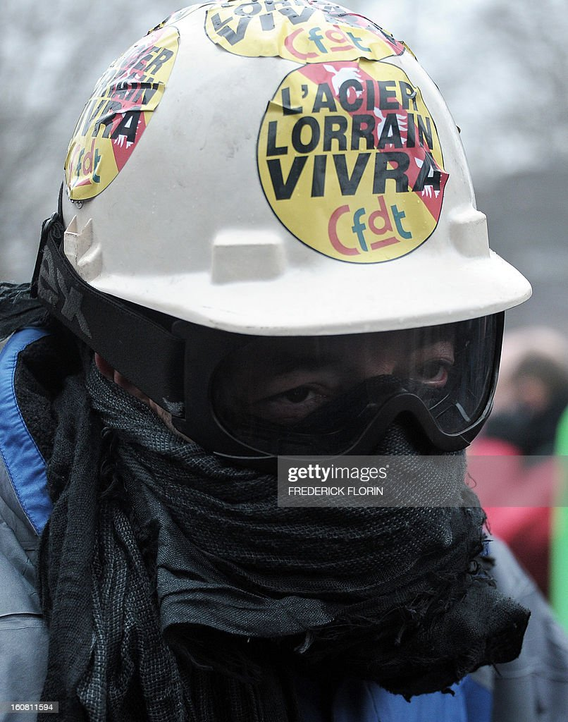 A sticker on the helmet of a demonstrator reads : 'Steel from Lorraine (French region) will live' during a demonstration of workers from several European Arcelormittal steel plants.s who cordon off the area near the European Parliament in Strasbourg, eastern France, on February 6, 2013, The world's top steel producer ArcelorMittal stumbled into the red last year with a net loss of $3.72 billion (2.75 billion euros) largely due to costs related to Europe.