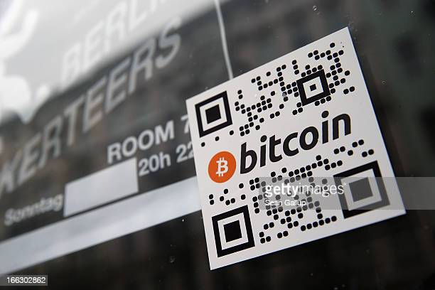 A sticker on the window of a local pub indicates the acceptance of Bitcoins for payment on April 11 2013 in Berlin Germany Bitcoins are a digital...