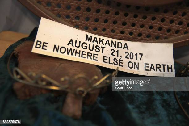 A sticker promoting the city as a solar eclipse destination sits in an artisan's shop on August 18 2017 in Makanda Illinois With approximately 2...