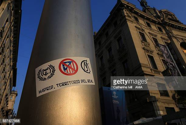 A sticker saying Madrid property of Real and a cross through the Atletico Madrid club badge on a lamp post ahead of the final at Stadio Giuseppe...