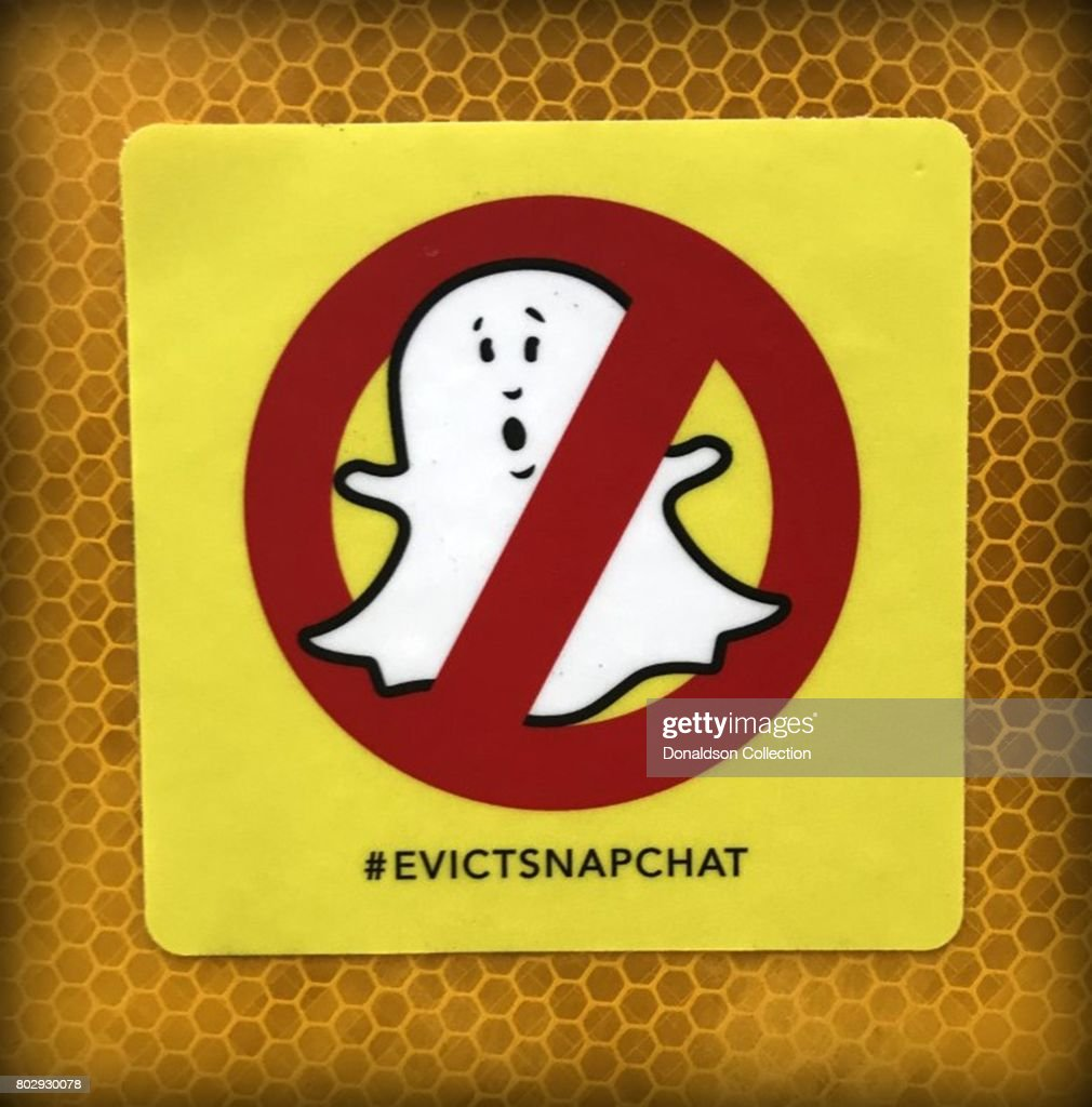 A sticker with a depiction of the Snapchat ghost and circle with a line through it reads #evictsnapchat in June 2017 in Venice, California.