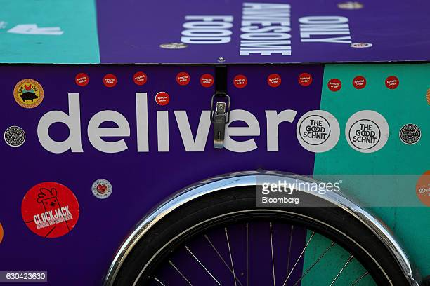 Stickers adorn a Deliveroo operated by Roofoods Ltd branded box on a cargo bicycle in London UK on Thursday Dec 22 2016 The food delivery business...