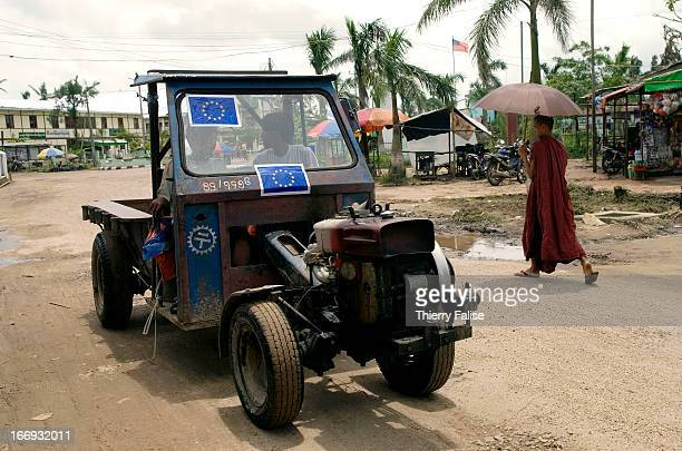 Stickers bearing the European Union's logo are stuck on tractors in Kun Yangon a town heavily damaged by cyclone Nargis According to official figures...
