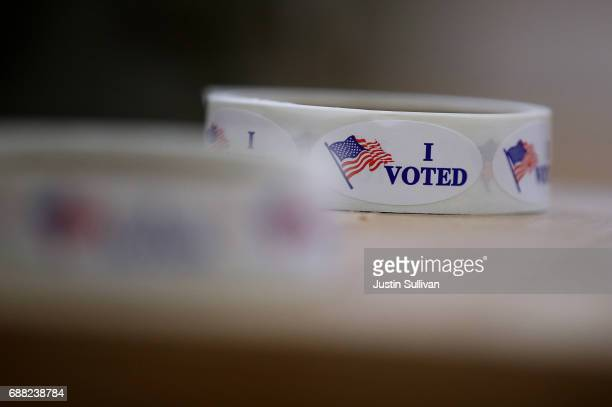 Stickers sit on a table in a polling station at Hellgate Elementary School on May 25 2017 in Missoula United States Montanans are heading to the...