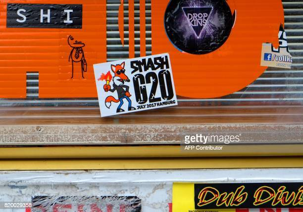 Stickers which adress the G20 summit are pictured on walls and lightpoles in Hamburg northern Germany on July 202017 / AFP PHOTO / PATRIK STOLLARZ