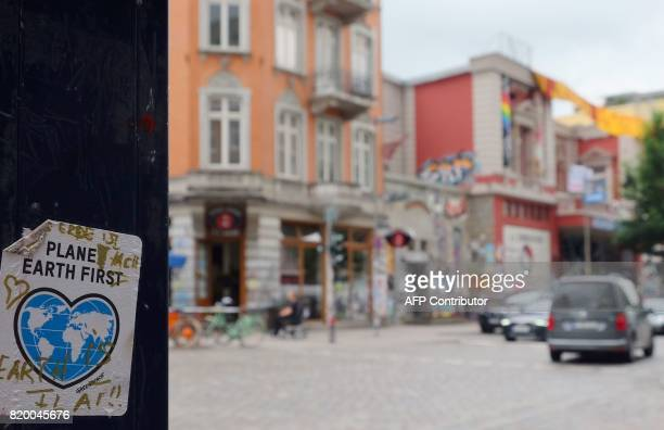 Stickers which adress the G20 summit are pictured on walls and lightpoles in Hamburg northern Germany on July 20 2017 / AFP PHOTO / PATRIK STOLLARZ