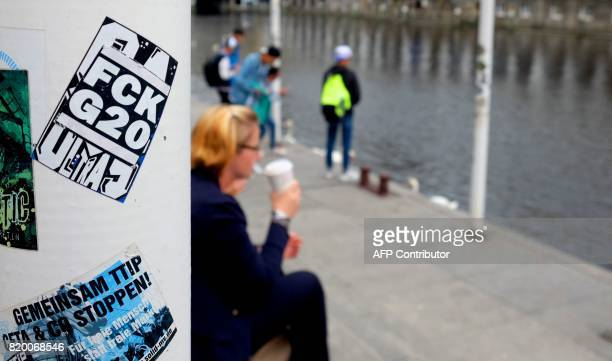 Stickers which adress the past G20 summit are pictured on walls and lightpoles in Hamburg northern Germany on July 20 2017 / AFP PHOTO / PATRIK...