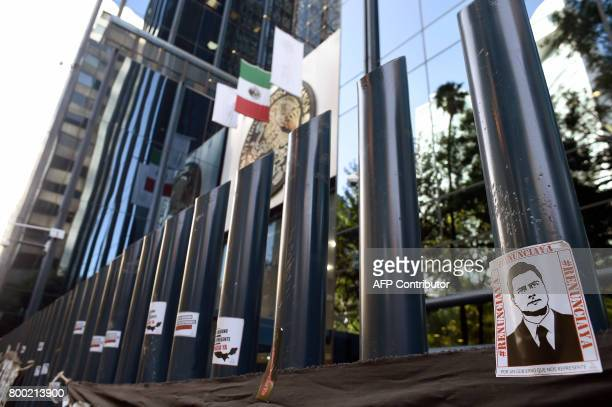 Stickers with the image of Mexican President Enrique Pena Nieto are stuck on columns outside the building of the attorney general's office during a...