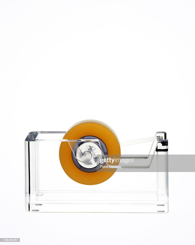 Sticking-tape dispenser with copy space : Stock Photo