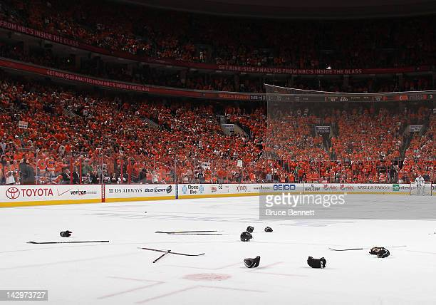 Sticks and gloves litter the ice following a fight between the Pittsburgh Penguins and the Philadelphia Flyers in Game Three of the Eastern...