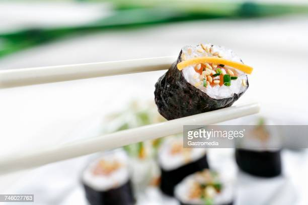 Sticks and sesame salmon sushi