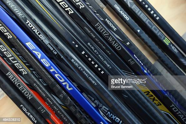 Sticks belonging to the New York Riveters of the National Womens Hockey League sit in a rack prior to the game at the Aviator Sports and Event Center...